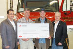 Fireman's Fund Insurance presents check to Beaver Island Fire Department