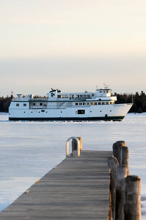 Emerald Isle passes the dock at CMU Boathouse